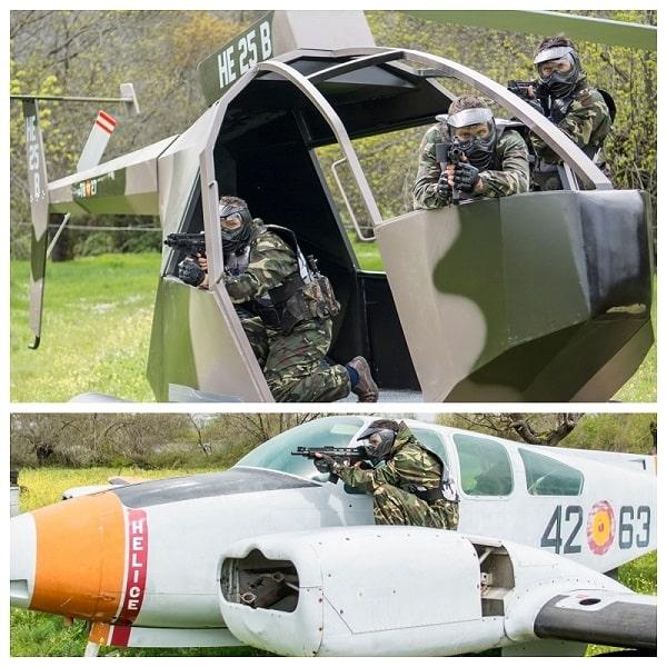 Dos equipos jugando al Paintball en Gran Paintball Madrid escondidos tras el helicóptero y el avión